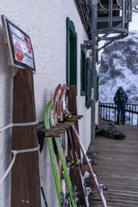 Europe, Austria, Berchtesgaden Alps, Salzburg, Werfen, Ostpreussenhütte, touring skis on the terrace of the Ostpreussenhütte
