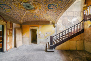 Stairwell in an abandoned villa with stuccoed ceiling