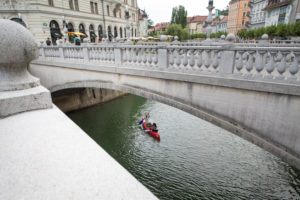 The Three Bridges and Canoeists in Ljubljana, Slovenia