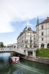 Excursion boat at the Three Bridges in Ljubljana, Slovenia