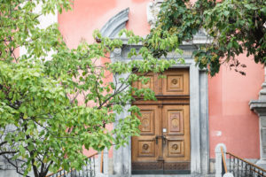 Man at the front door of the Church of the Annunciation, Ljubljana, Slovenia
