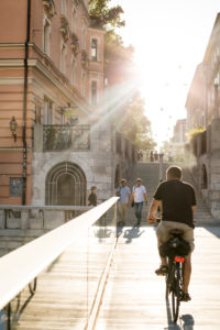 Ljubljana, downtown, people come from a staircase to a bridge