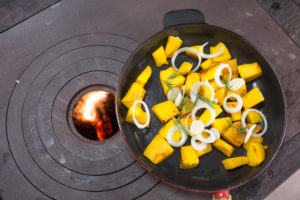 Pumpkin pan in cast iron pan on wood stove