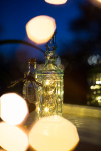 Chain of lights in a glass bottle