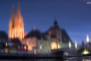Regensburg Cathedral and houses reflecting in the waters of the Danube in Regensburg,
