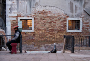 Gondolier is waiting for customers in Venice, Italy