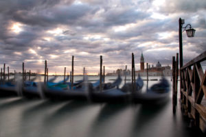 Gondolas in the lagoon of Venice, sunrise, Italy