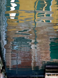 Water reflection in a canal in Venice, Italy