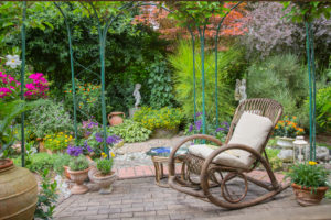 Garden terrace with rocking chair and various plants