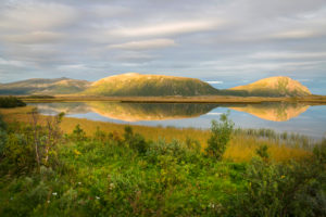 Landscape with water reflection and evening light, Vesteralen, Norway, Scandinavia