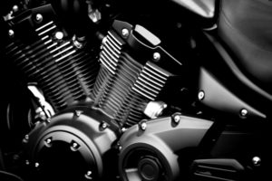Close-up of a modern black painted engine block of a motorcycle.