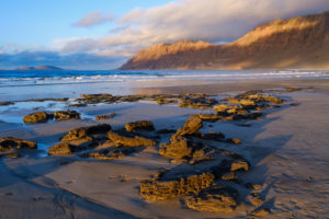 Beach in Caleta de Famara, left La Graciosa, Risco de Famara, Lanzarote, Canary Islands, Spain