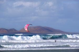 Kitesurfer, Playa de Famara at Caleta de Famara, behind La Graciosa island, Canary Islands, Spain