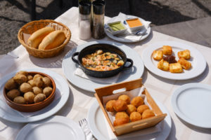 Tapas, croquettes, papas arrugadas, prawns in garlic, goat's cheese, Playa Quemada at Yaiza, Lanzarote, Canary Islands, Spain