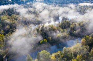 Fog over forest and pond, Birkensee and Isar-Loisach Canal near Geretsried, drone recording, Upper Bavaria, Bavaria, Germany