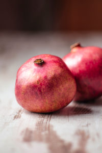 Two pomegranates, close-up