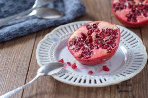 Half pomegranate on old porcelain plate