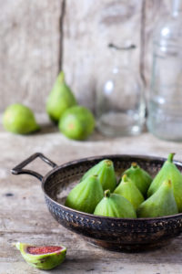 Rustic still life with fresh green figs on wood
