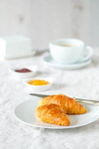 Fresh croissants on a breakfast table