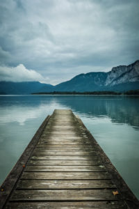 Jetty on moon lake with dramatic sky