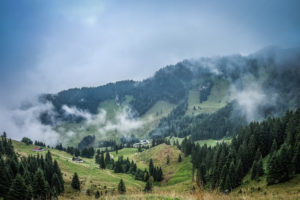 Mountain landscape with low clouds and fog
