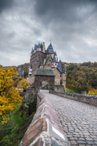 The autumnal castle Eltz in cloudy sky.