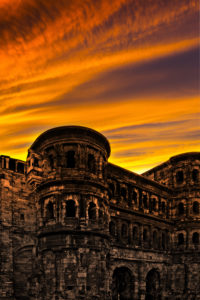 The Porta Nigra in Trier with glowing red evening sky