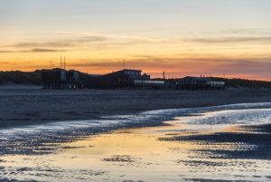 Coastal scenery with sundown at North Sea near Renesse