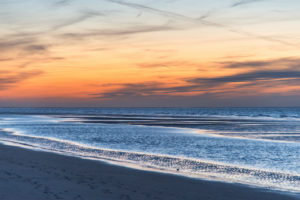 Evening beach landscape with sunset at the North Sea beach at Renesse, Netherlands.