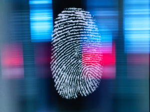 Finger print on digital screen being scanned