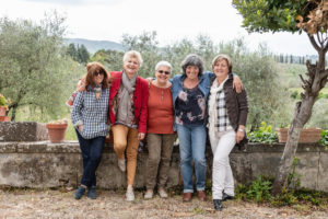 Portrait of senior women, olive trees in background, Florence, Italy