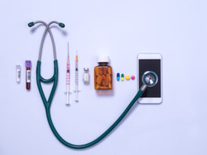 Telemedicine and medical equipment, stethoscope connected to a smart phone online to connect to a healthcare professional and range of syringes and medicines.