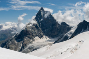 Switzerland, Valais, Haute Route Chamonix Zermatt, Stockji glacier with Matterhorn - Zmuttgrat, west face and Liongrat