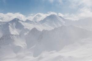 Schweiz, Graubünden, Schneegestöber im Tal von Samnaun mit Piz Malmurainza, Piz Salet, Muttler