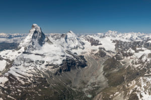 Switzerland, canton of Valais, Valais Alps, Zermatt, Matterhorn with Furgggrat, east wall, Hörnligrat and Hörnlihütte, north wall, Matterhorn glacier, Bergschrund, Zmuttgrat, Dent d'Herens Stockjigletscher, Zmutt glacier, in the background Mont Blanc and Grand Combin