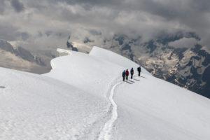 Switzerland, Canton of Valais, Saas Valley, Saas-Grund, mountaineers descending Weissmies west ridge