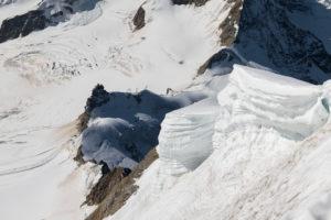 Switzerland, Canton Bern, Bernese Oberland, Canton Valais, Wechten at the summit of Mönch with Jungfraujoch, Top of Europe, Jungfraufirn