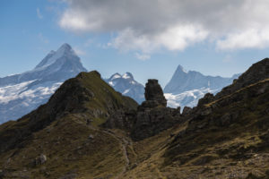 Switzerland, Canton Bern, Bernese Oberland, Grindelwald, First, rock formation at Hireleni with a view of Lauteraarhorn, Schreckhorn, Finsteraarhorn