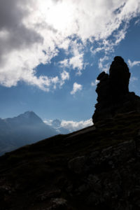 Switzerland, Canton Bern, Bernese Oberland, Grindelwald, First, rock formation at Hireleni with a view of Eiger north face, Jungfrau