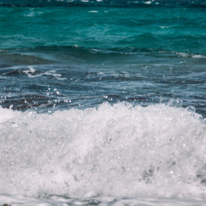 Summer holiday on Formentera, cliff walk, strong swell