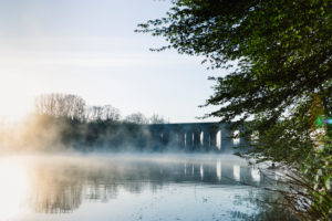 Sunrise and fog at Obersee Reservoir in Bielefeld