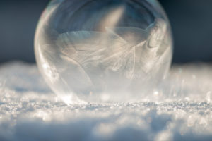 Ice ball in the snow, close-up