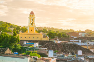 The roofs over Trinidad with the former Franciscan monastery in the background, morning mood with haze, Cuba