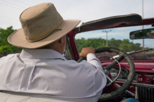 Vintage car convertible with driver in Cuba, cult, Cuban