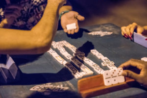 Detail views of dominoes players, parlour game