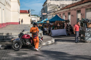 Tourist market in Santa Clara, waiting man with motorcycle and side car, Cuba