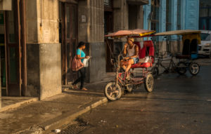 Rickshaw driver waiting for customers in Havana, Cuba