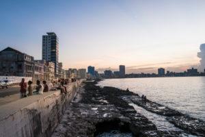 Malecon in Havana Cuba, people sitting on the Malecon, evening mood, quiet sea