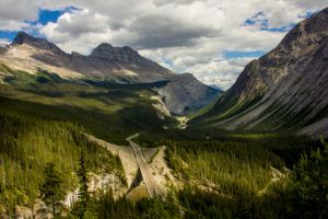 Street through the Canadian Rocky Mountains, mountains, forests, light and shadow, Canada