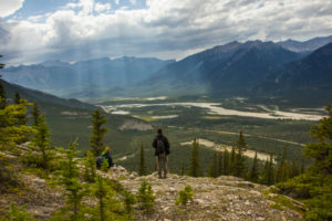 Rocky Mountains, hiker, valley with sunrays, Canada